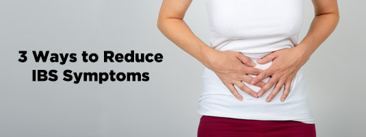 woman hands on stomach - ibs